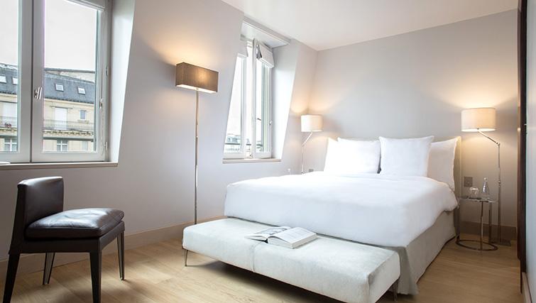 Double bed at La Reserve Paris Apartments