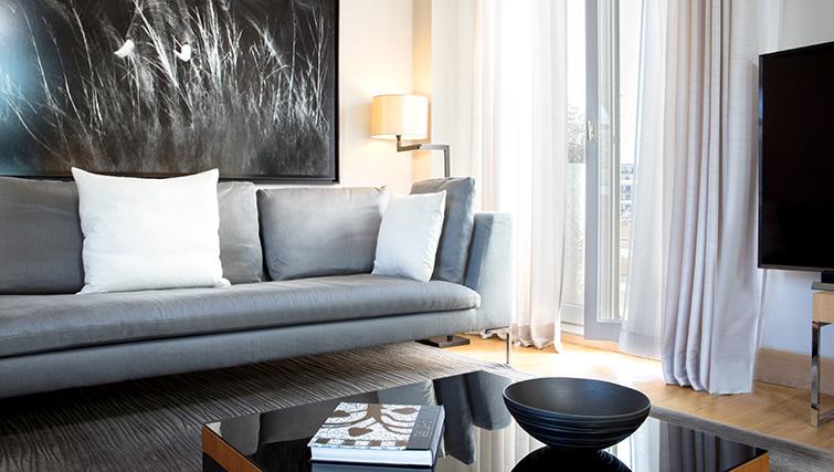 Sofa at La Reserve Paris Apartments