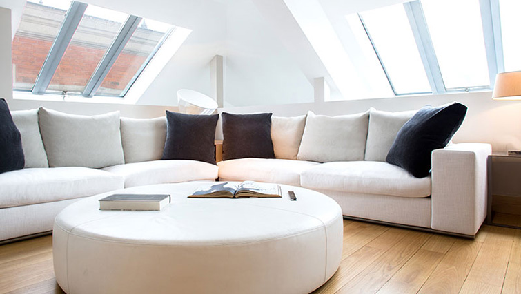 Bright lounge area at La Reserve Paris Apartments