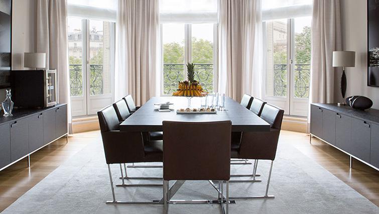 Dining table at La Reserve Paris Apartments