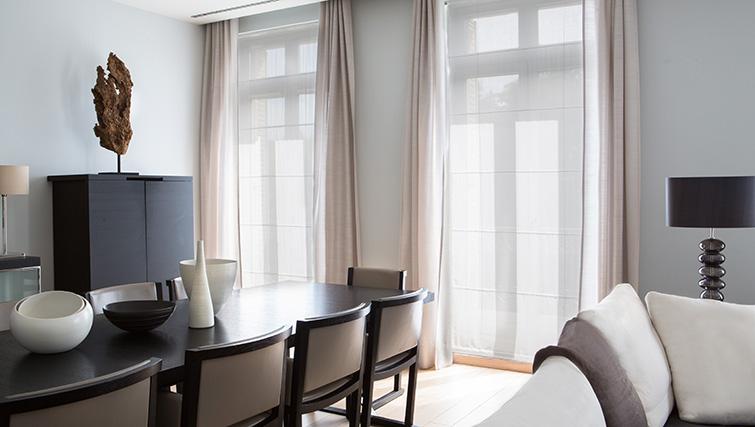 Modern dining area at La Reserve Paris Apartments