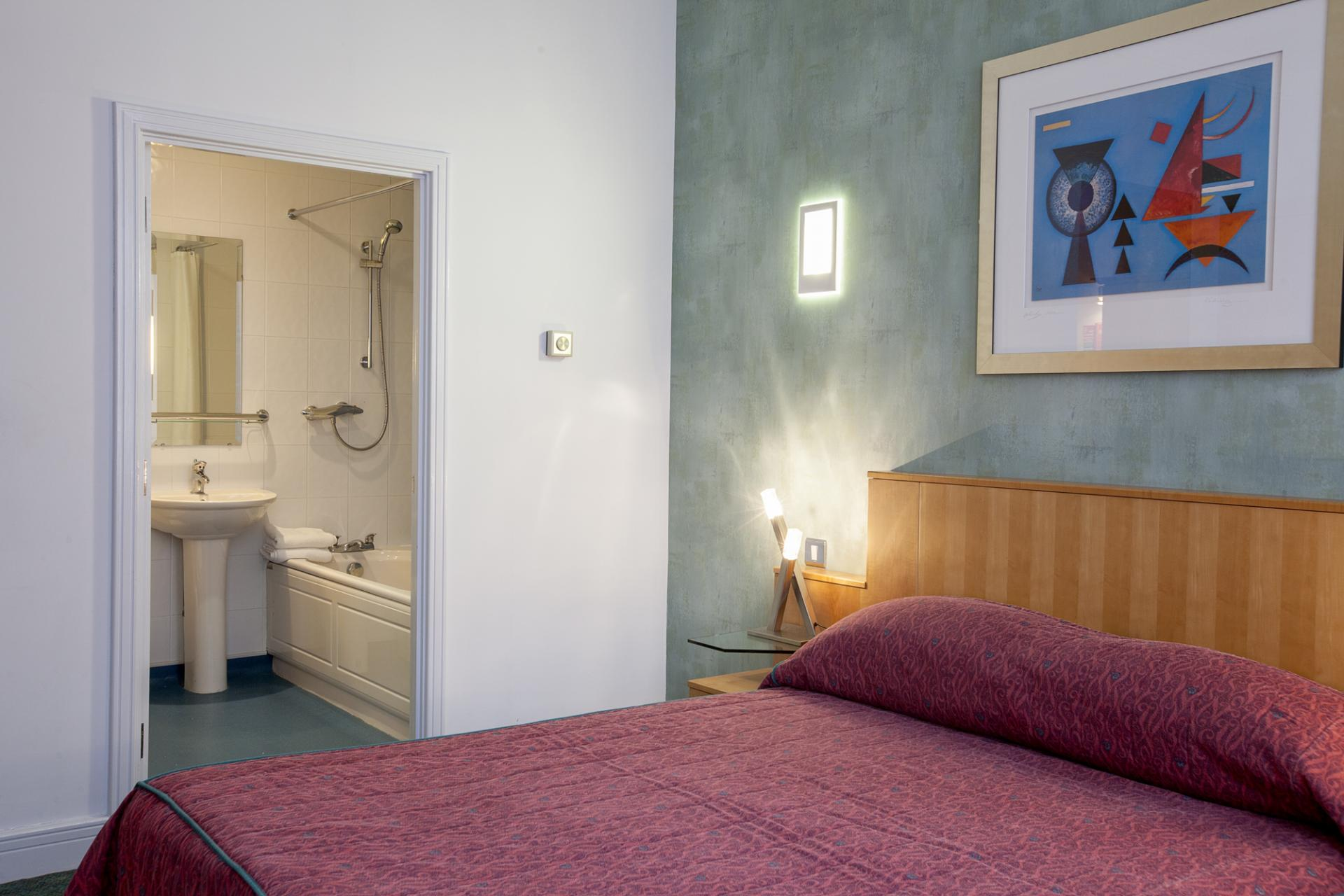 Comfortable bedroom at Pilcher Gate Serviced Apartments