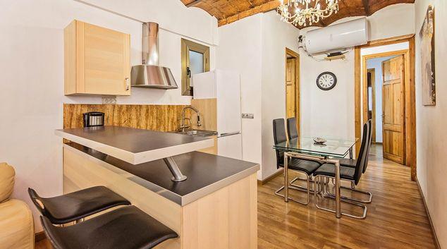 Kitchen diner at Joan Miro Apartment, Sant Antoni, Barcelona