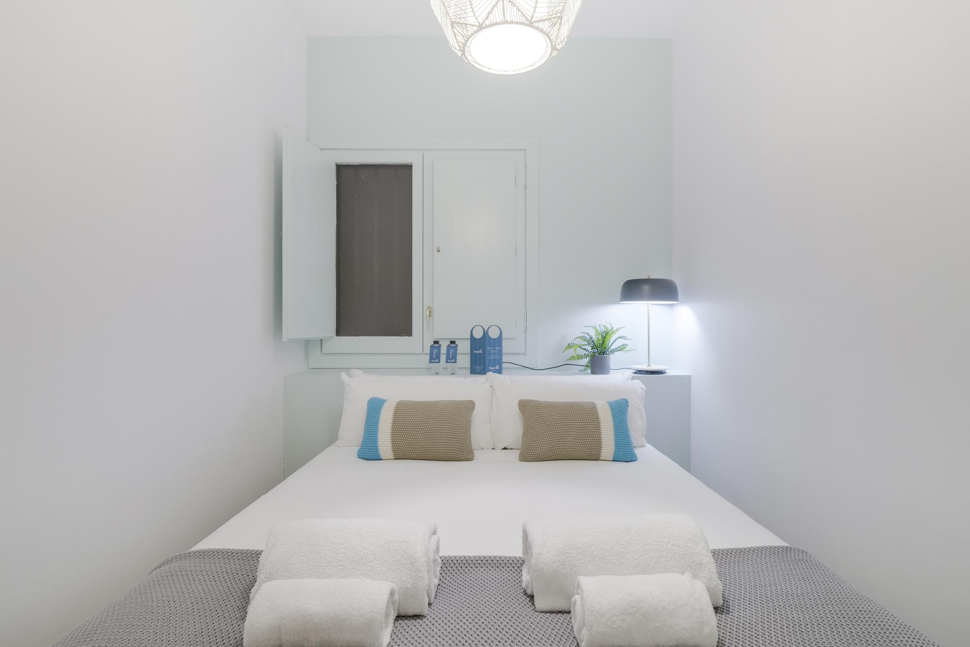 Double bed at Monumental Apartment