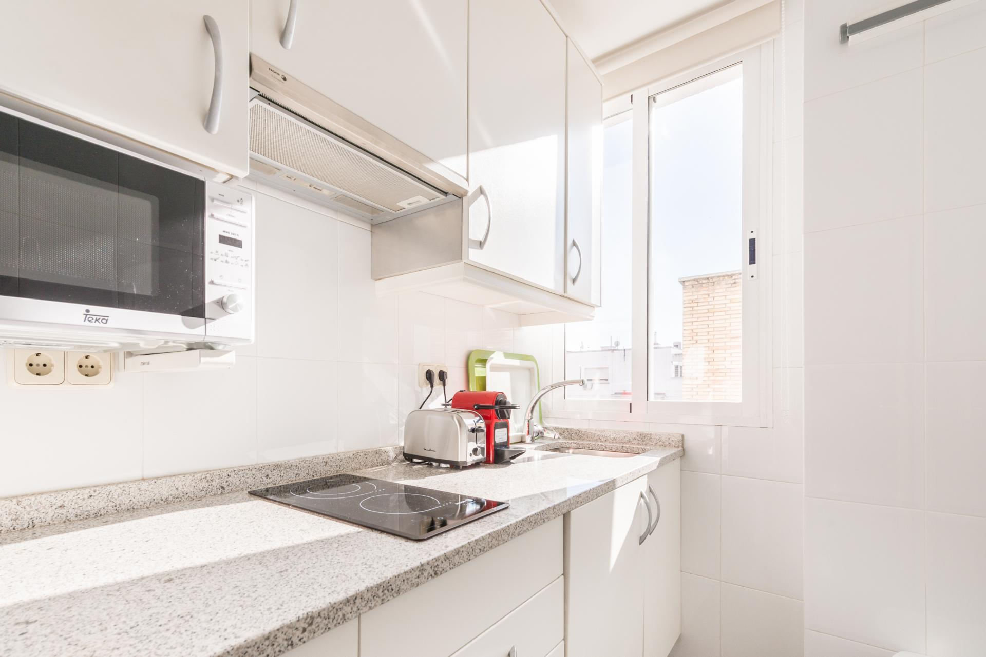 Kitchen at Bright Salamanca Apartment