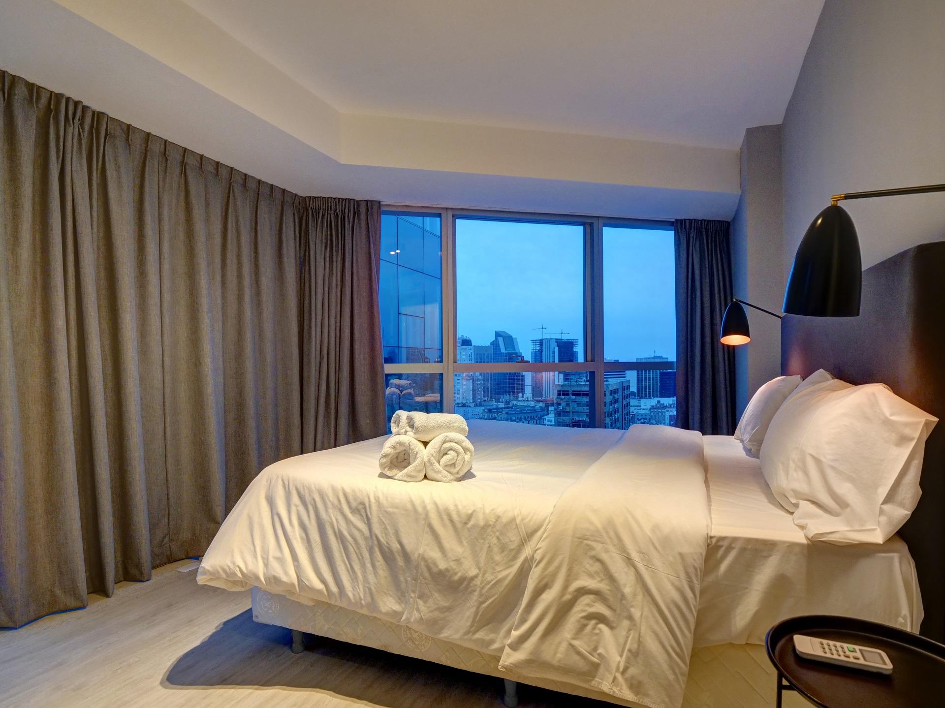 Bed at Bellini Esmeralda Apartments