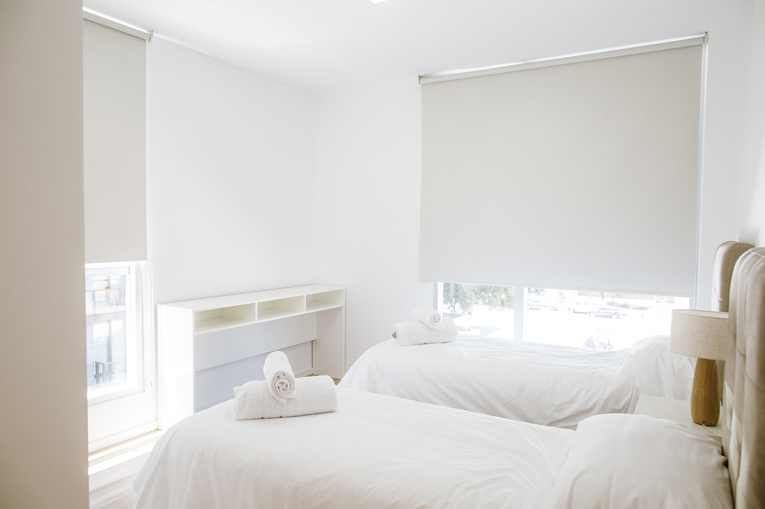 Bright twin room at Lumiere Apartments