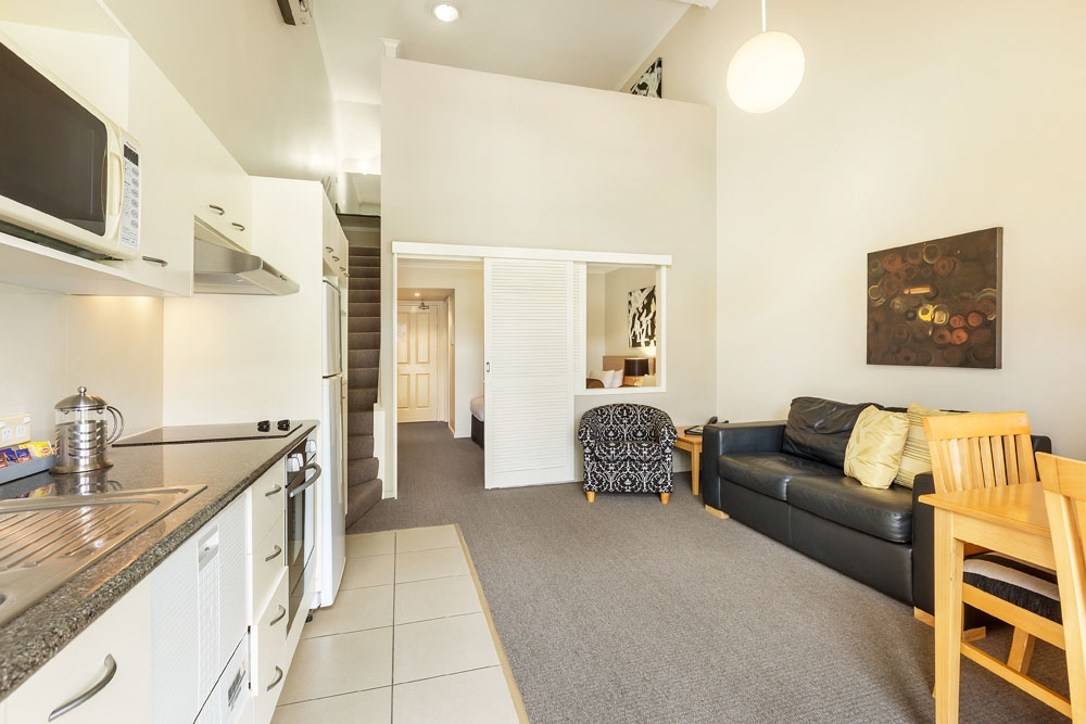 Two bedroom lounge/kitchen at Quest On Story Bridge