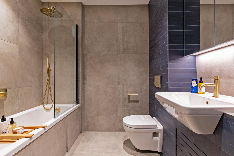 Bathroom decor at The Lofts E1 By Q Apartments
