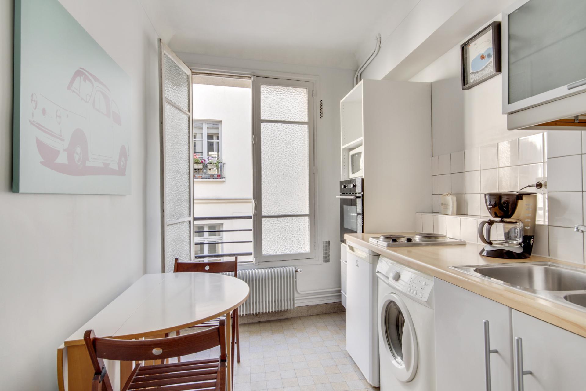 Bright bedroom at Rue Saint-Marc Apartments