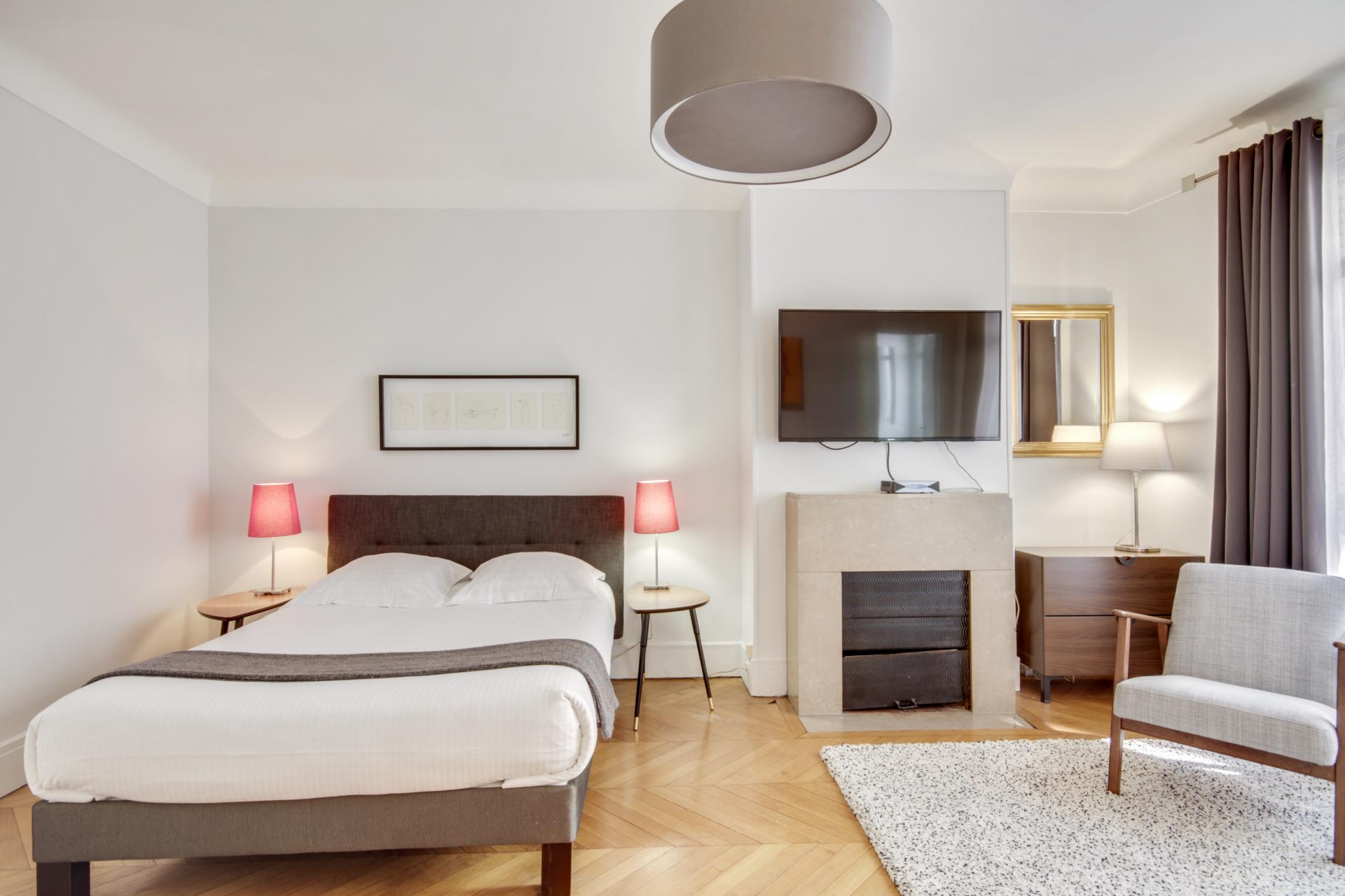 Double bed at Rue Saint-Marc Apartments