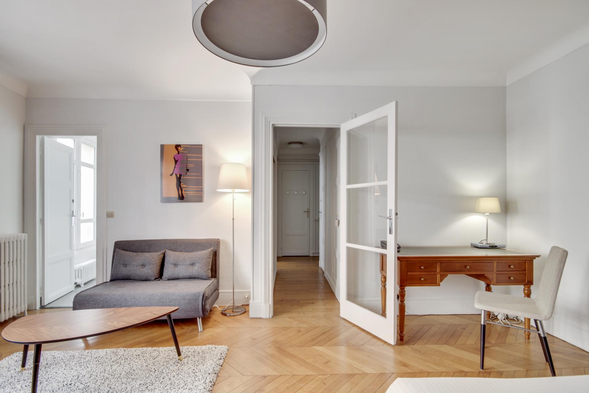 Spacious lounge at Rue Saint-Marc Apartments
