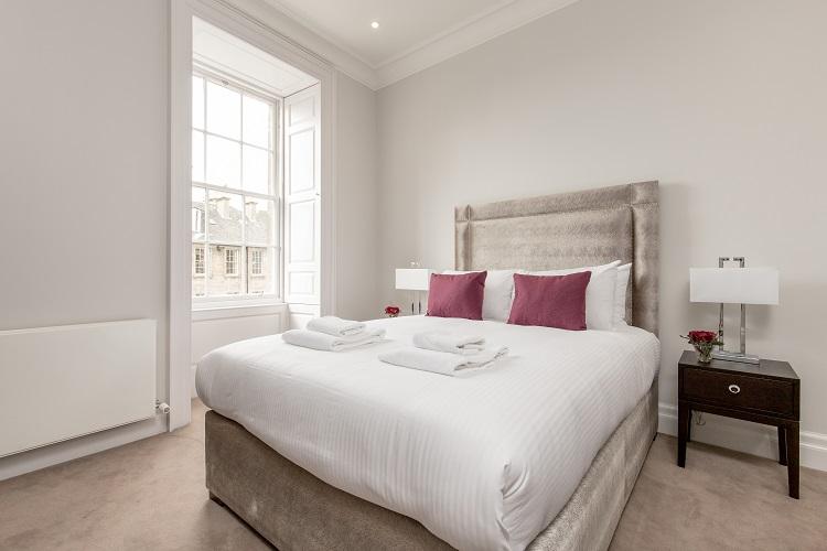 Stylish bedroom at Chisholm Hunter Suites