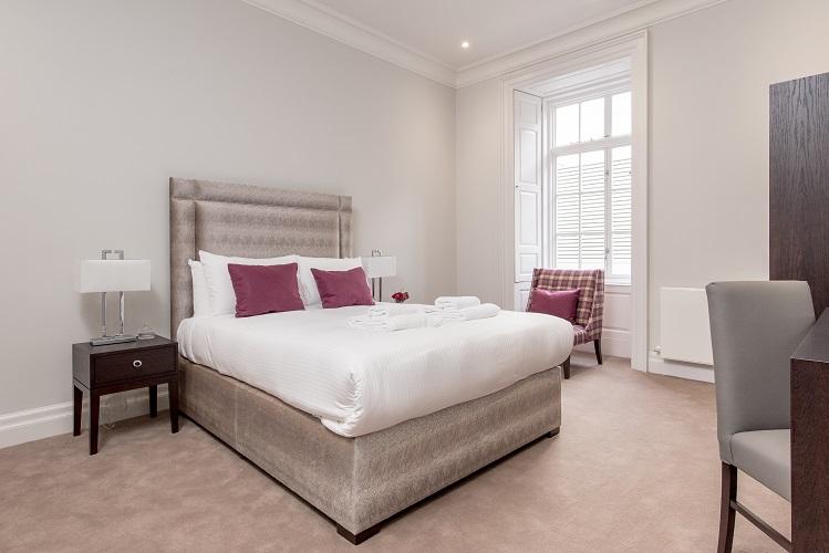 Bedroom at Chisholm Hunter Suites