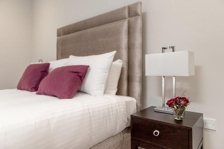 Modern bedroom at Chisholm Hunter Suites