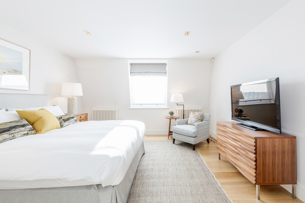 Bright bedroom at Snow on The Slopes Apartments