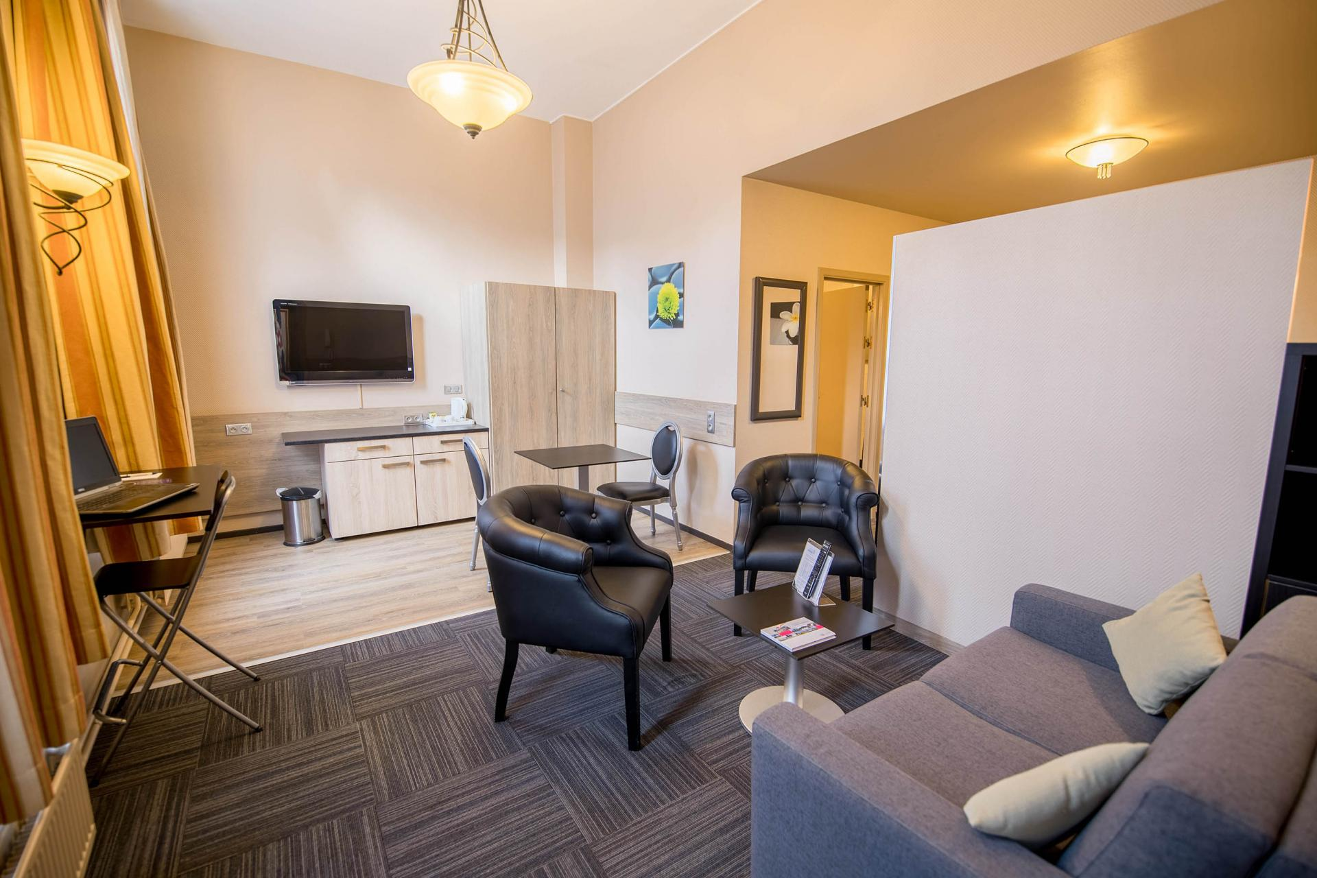 Living area at Infotel Apartments