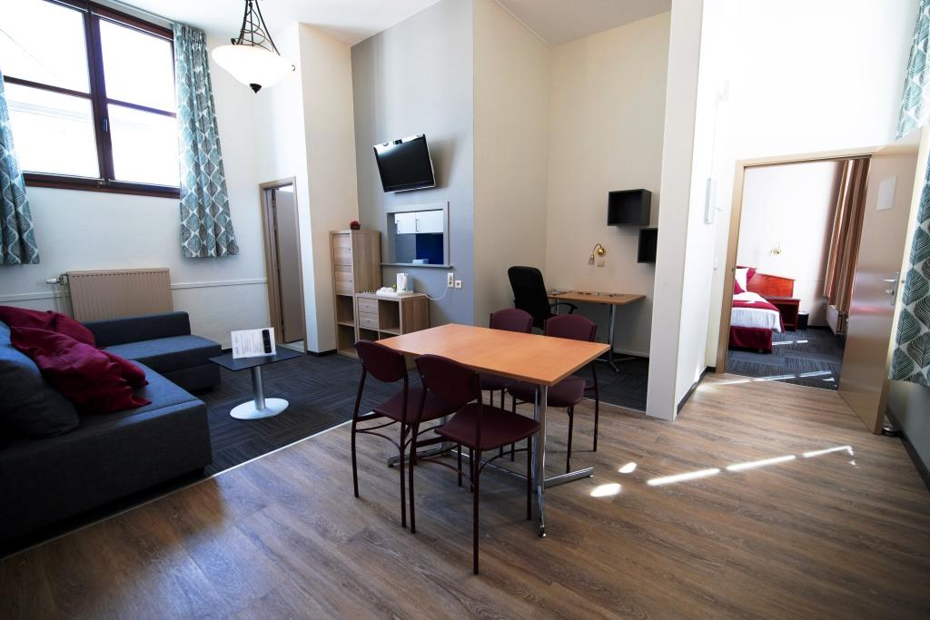 Living room at Infotel Apartments