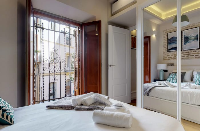 Charming bedroom at Conde De Torrejon 11 Apartment