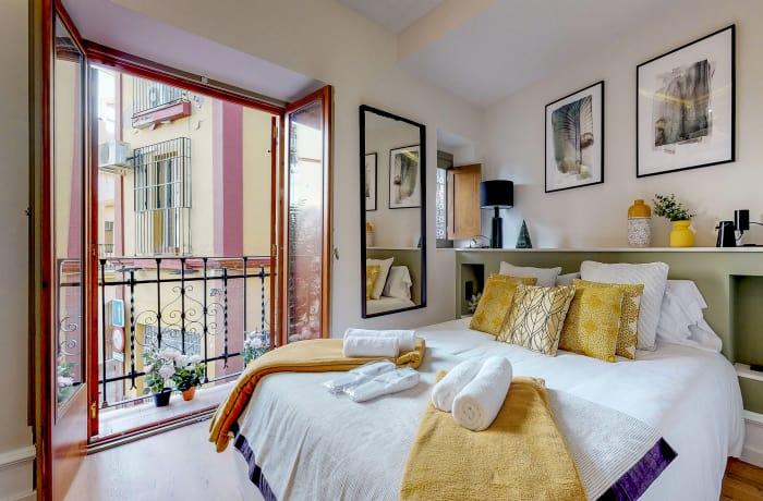 Bright bedroom at Conde De Torrejon 11 Apartment