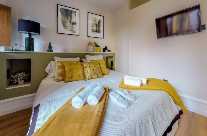 Modern bedroom at Conde De Torrejon 11 Apartment