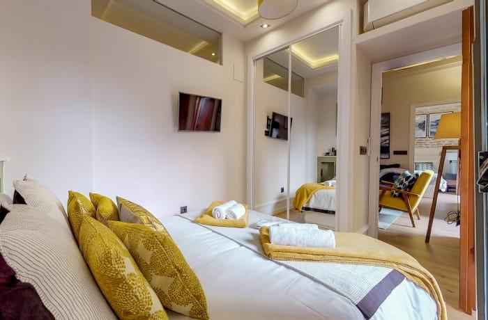 Double bed at Conde De Torrejon 11 Apartment
