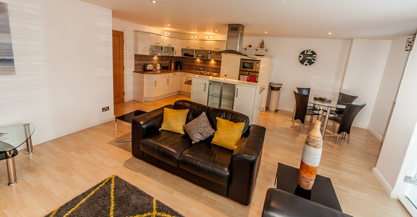 Open-plan living area at Queens Highlands Aberdeen Apartment