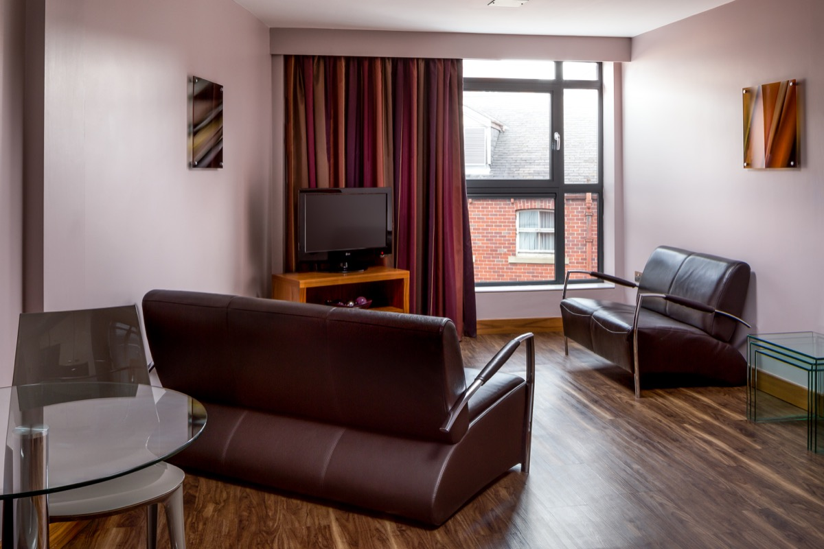Living room at Roomzzz Leeds City Apartments