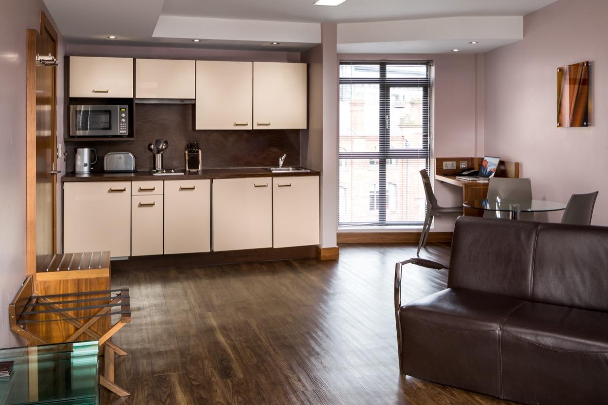 Kitchen at Roomzzz Leeds City Apartments