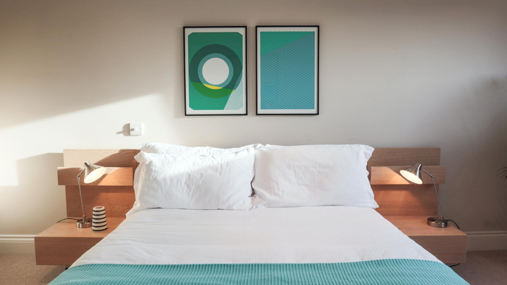 Bright bedroom at White Hill 5 Apartment