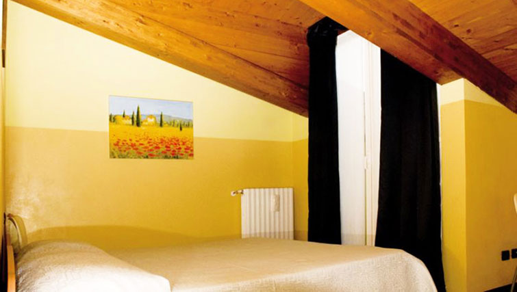Bed at Oasi Di Monza Apartments
