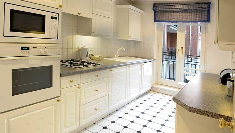 Equipped kitchen at Clevedon House Apartment