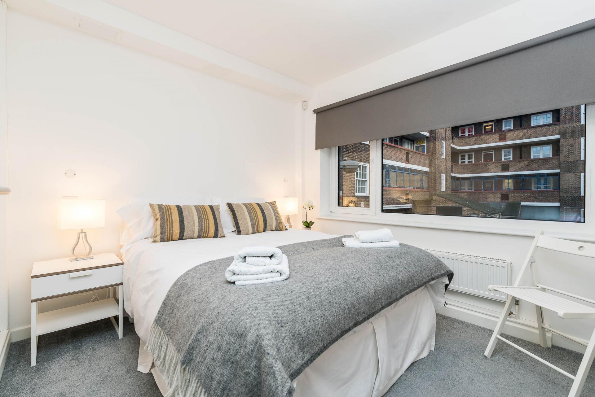Bedroom at Vibrant Vauxhall Apartments