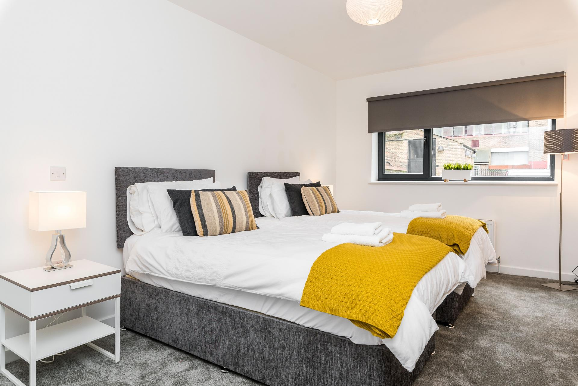 Twin beds at Vibrant Vauxhall Apartments