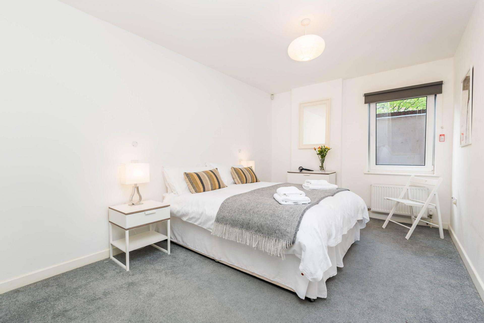 Spacious bedroom at Vibrant Vauxhall Apartments