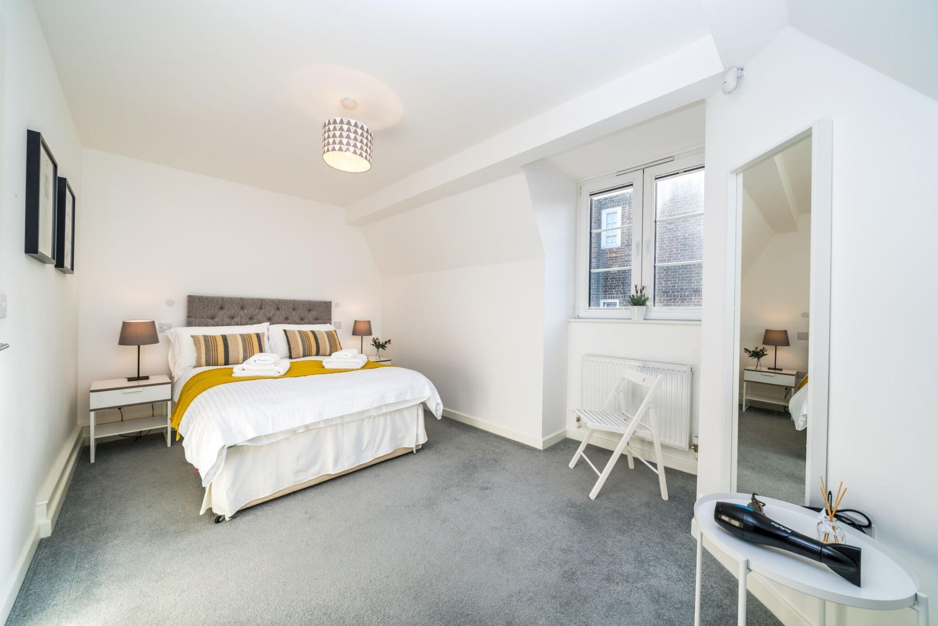 Stylish bedroom at Vibrant Vauxhall Apartments