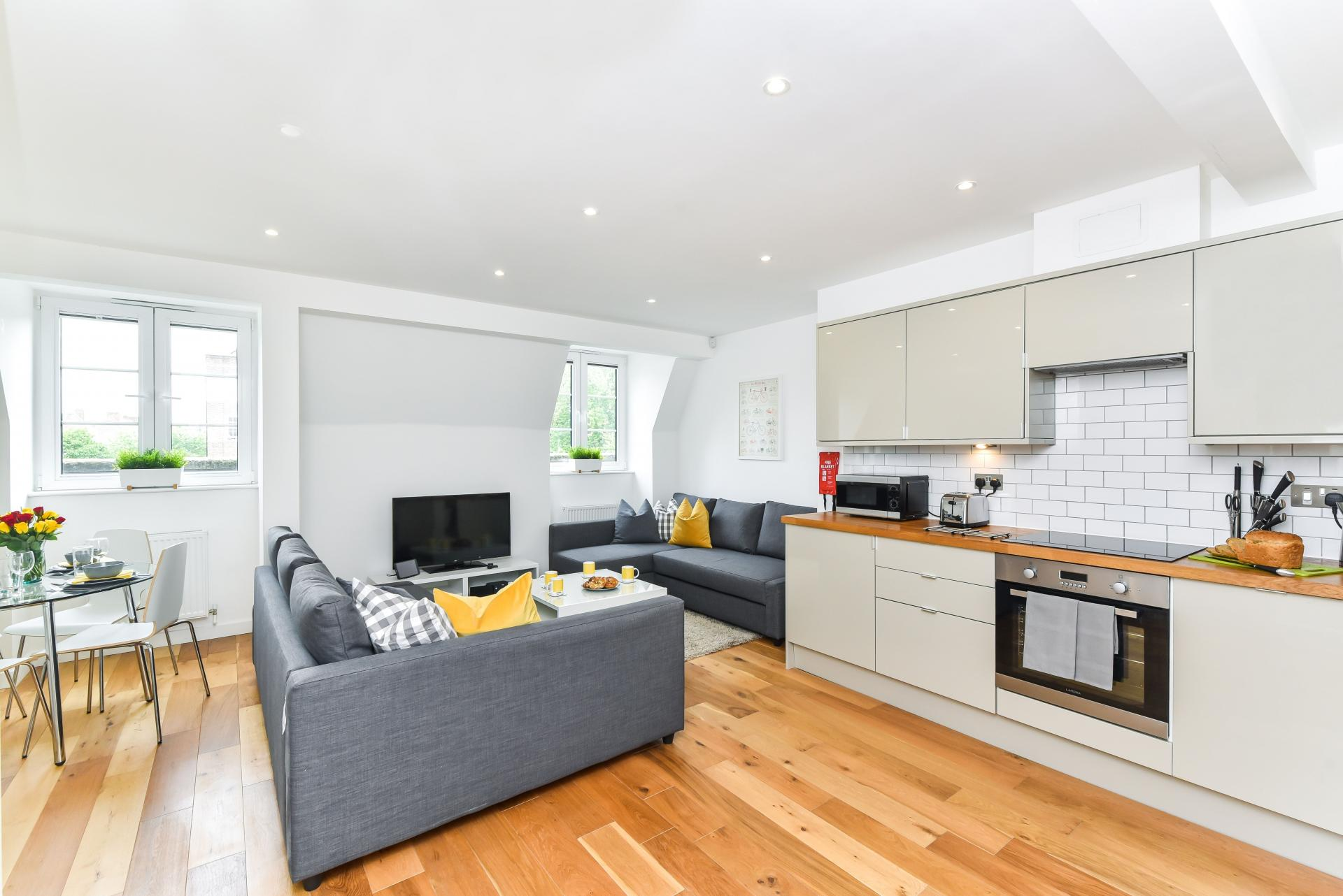 Open-plan living area at Vibrant Vauxhall Apartments