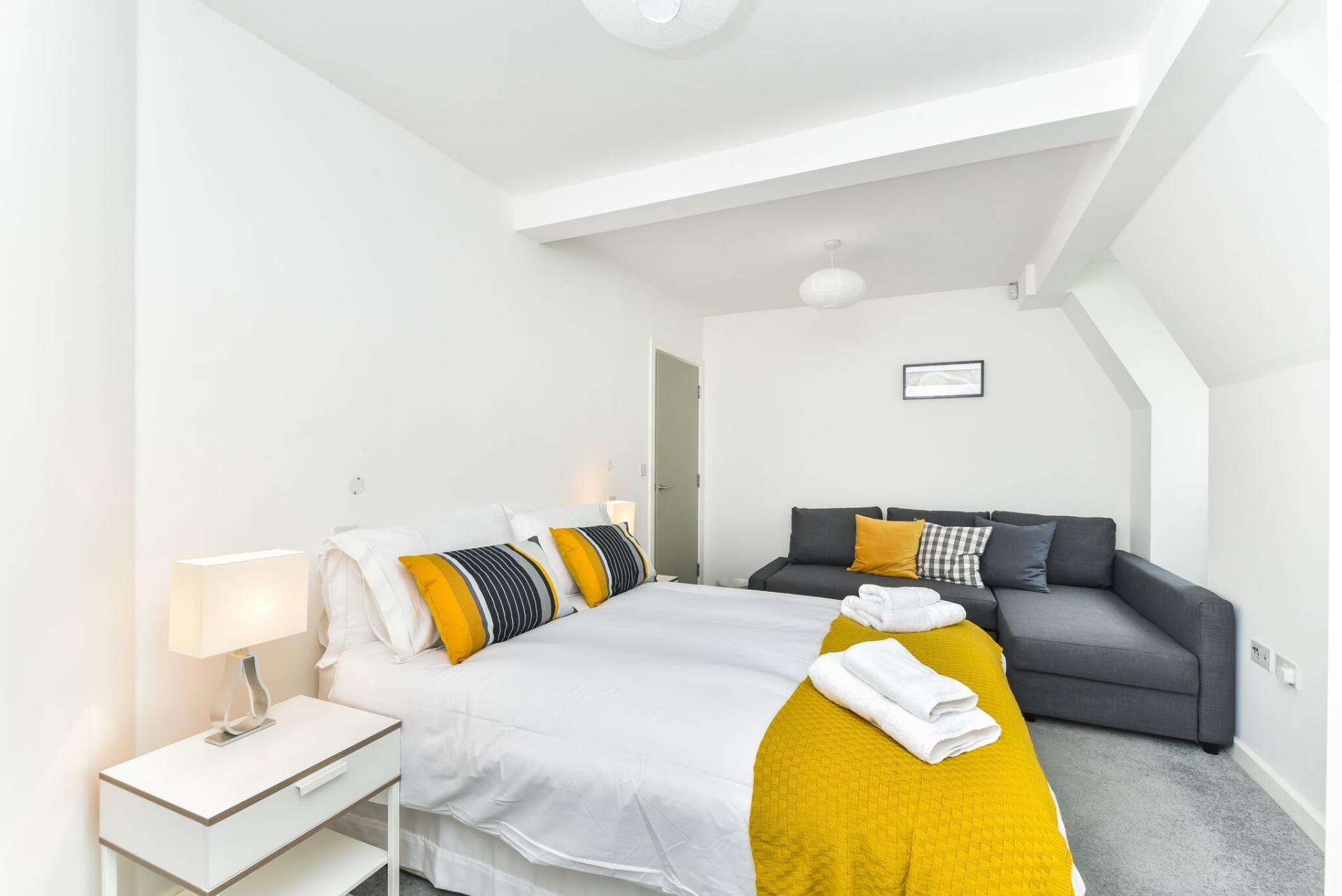 Cosy bedroom at Vibrant Vauxhall Apartments