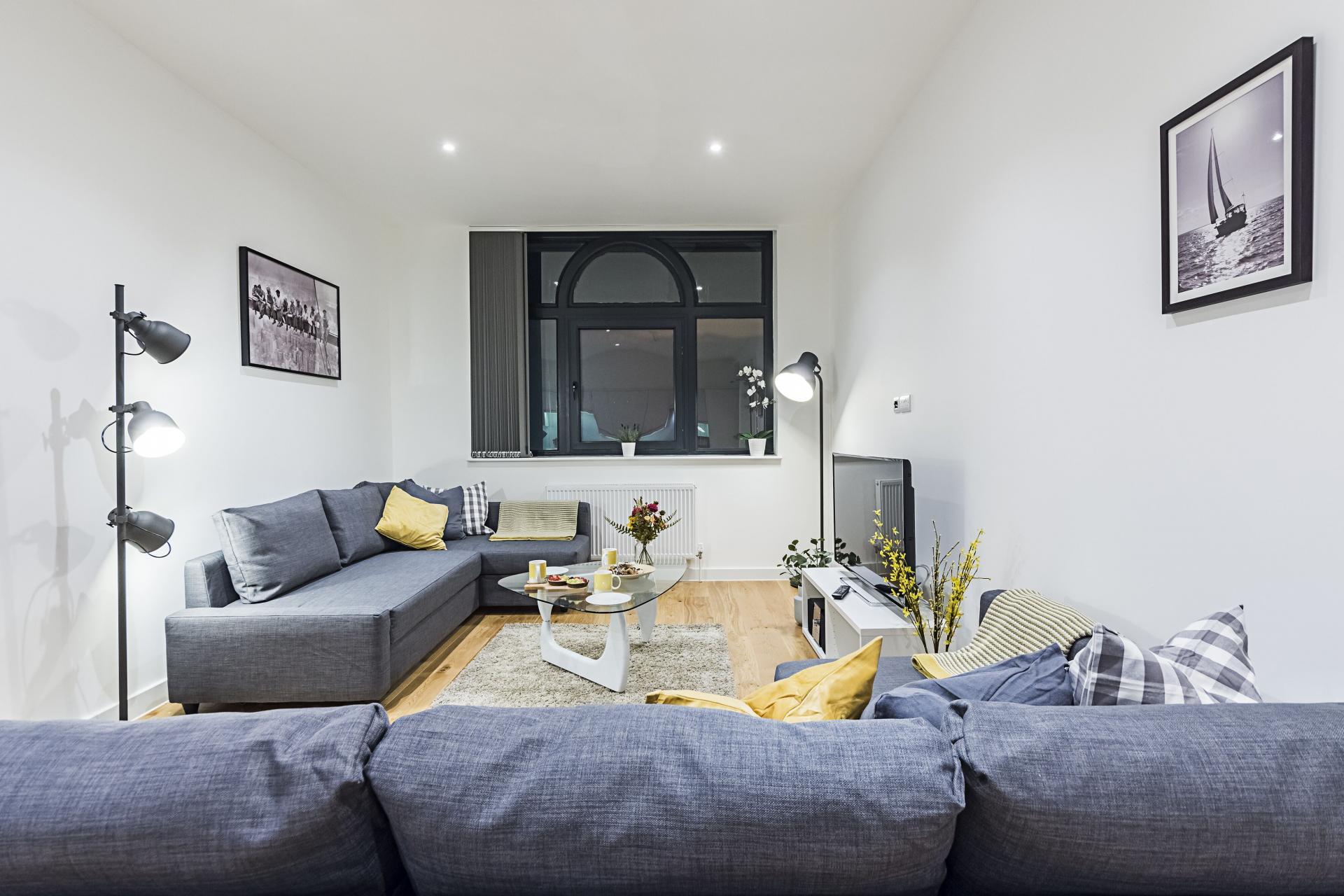 Modern lounge at Vibrant Vauxhall Apartments