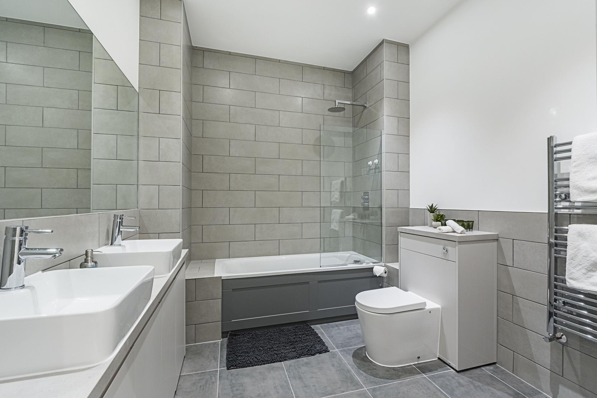 Large bathroom at Vibrant Vauxhall Apartments