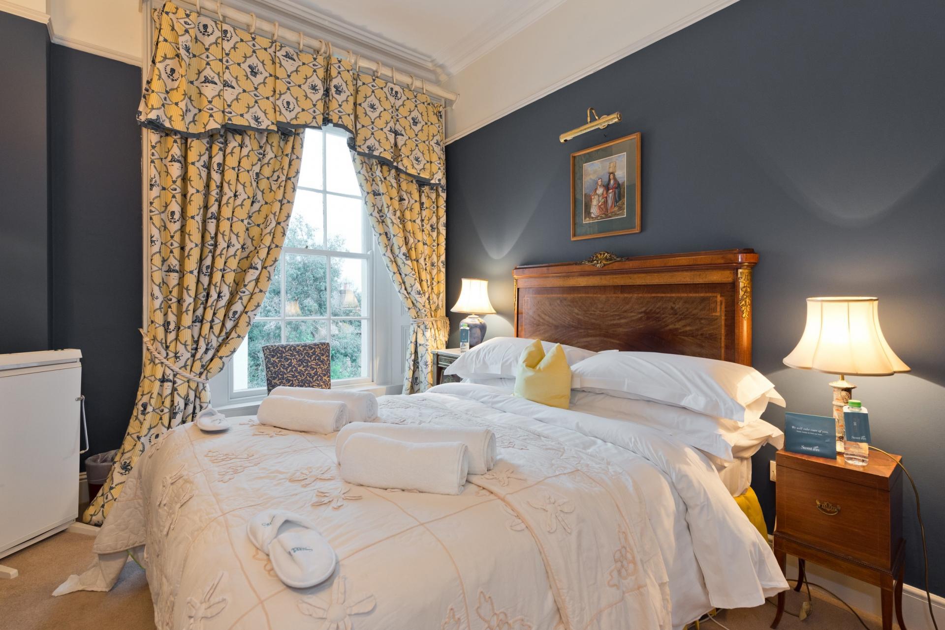 Grand bedroom at Elegant Ballsbridge Apartments