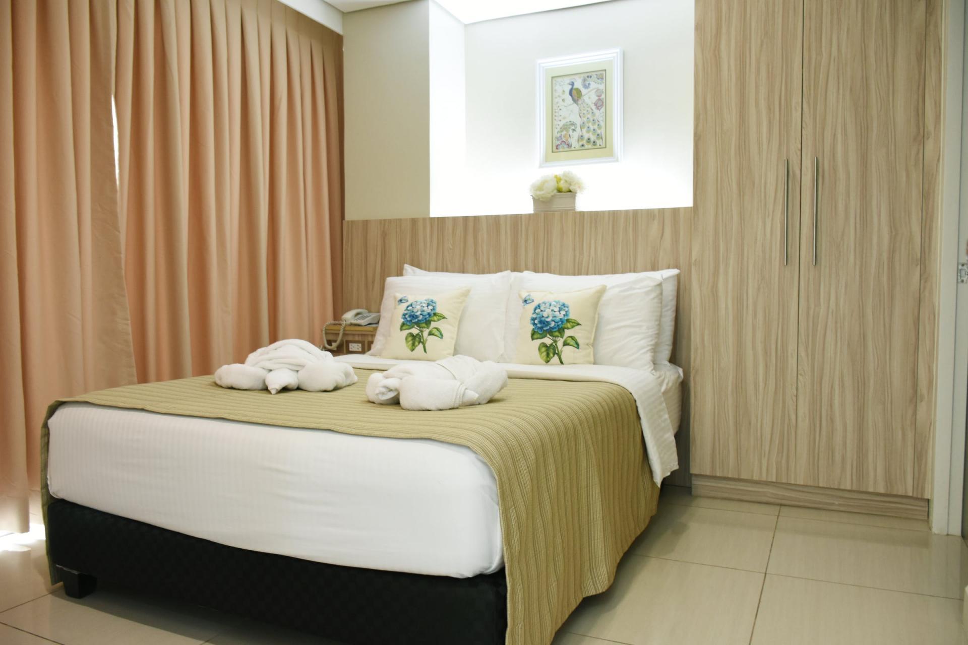 Bedroom at Alicia Apartelle Apartment