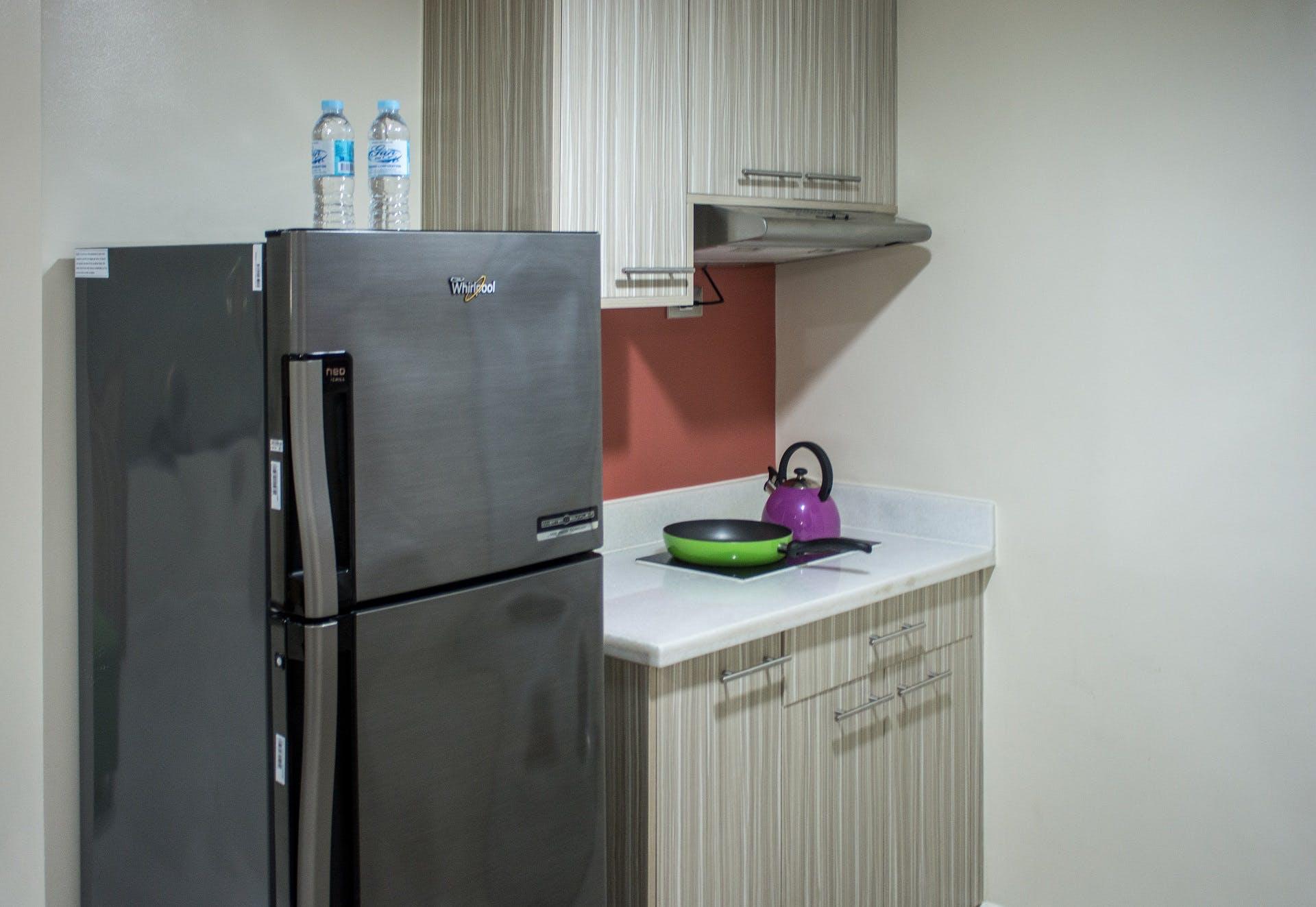 Kitchen at Alicia Apartelle Apartment