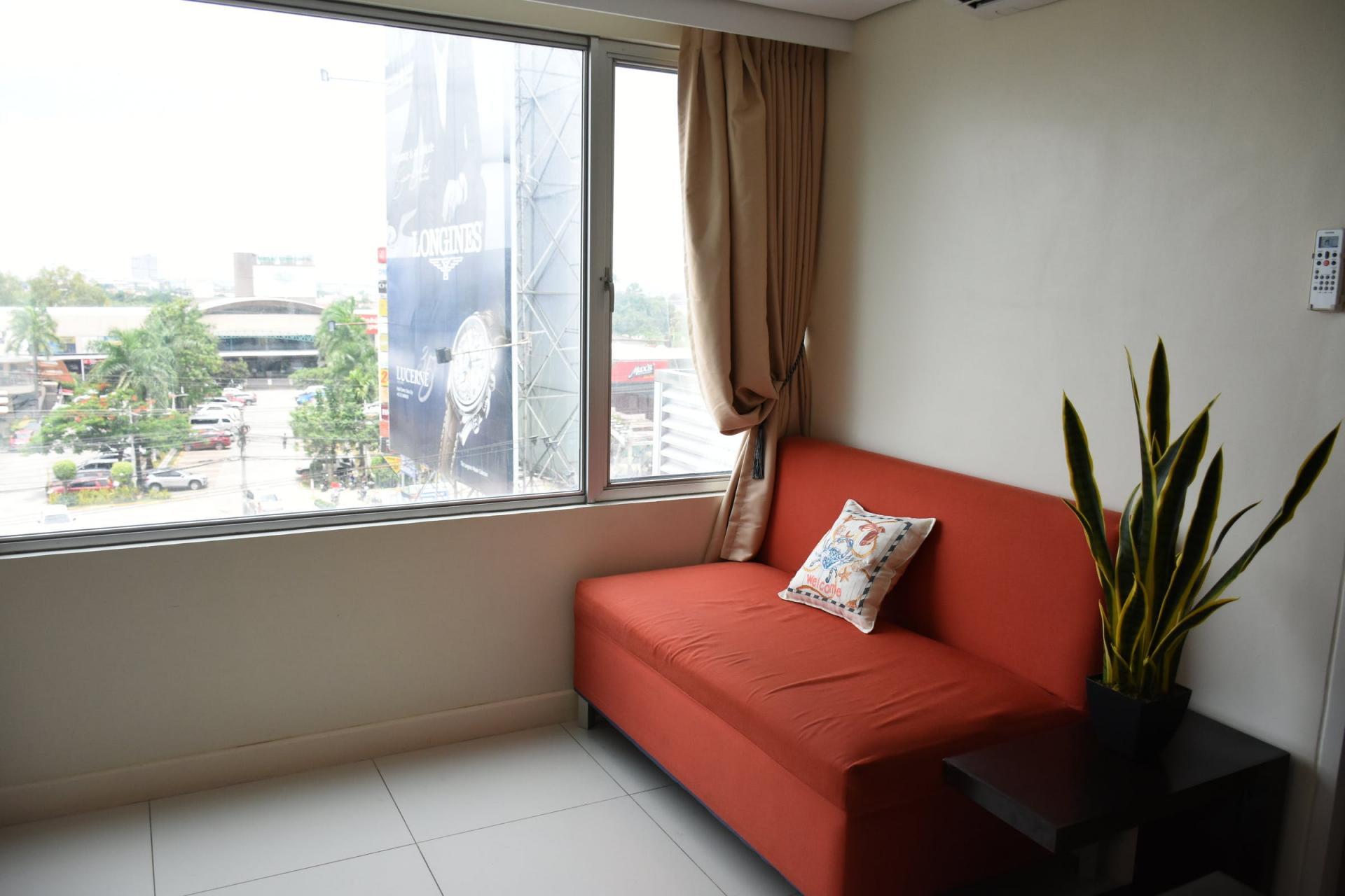 Bright lounge at Alicia Apartelle Apartment