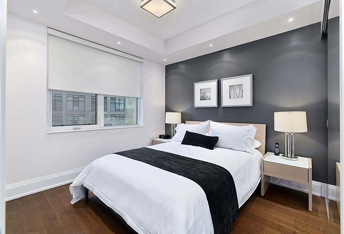 Modern bedroom at Old Mill Apartments
