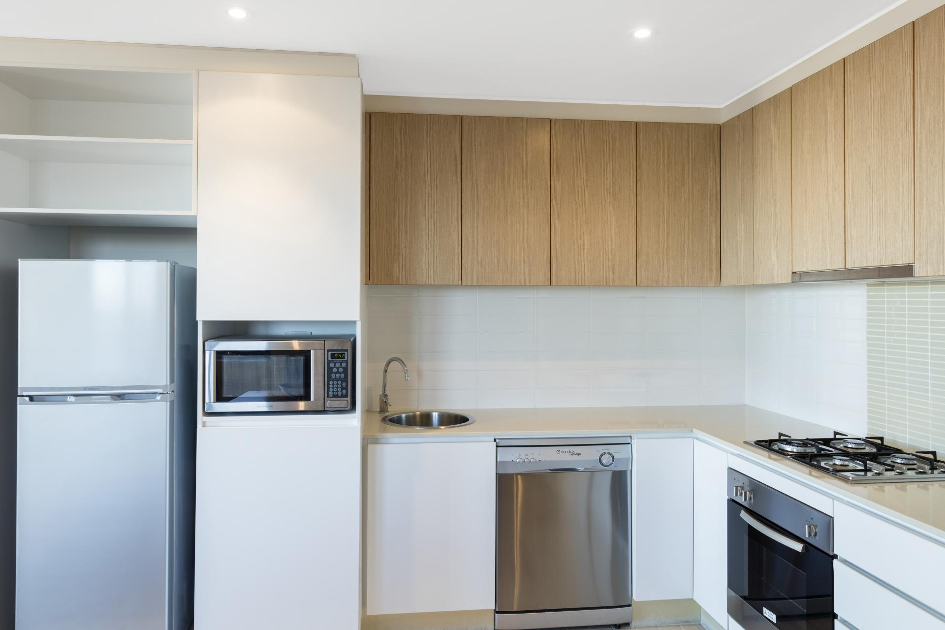 Kitchen at iStay Precinct Adelaide Apartments