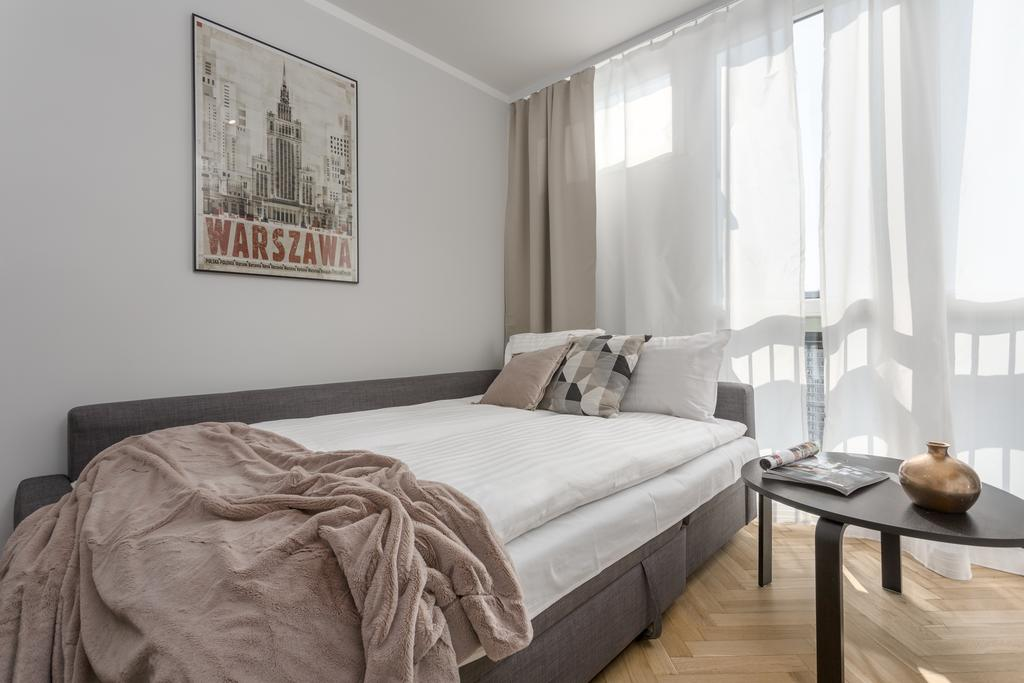Sofa bed at Grzybowska Apartment