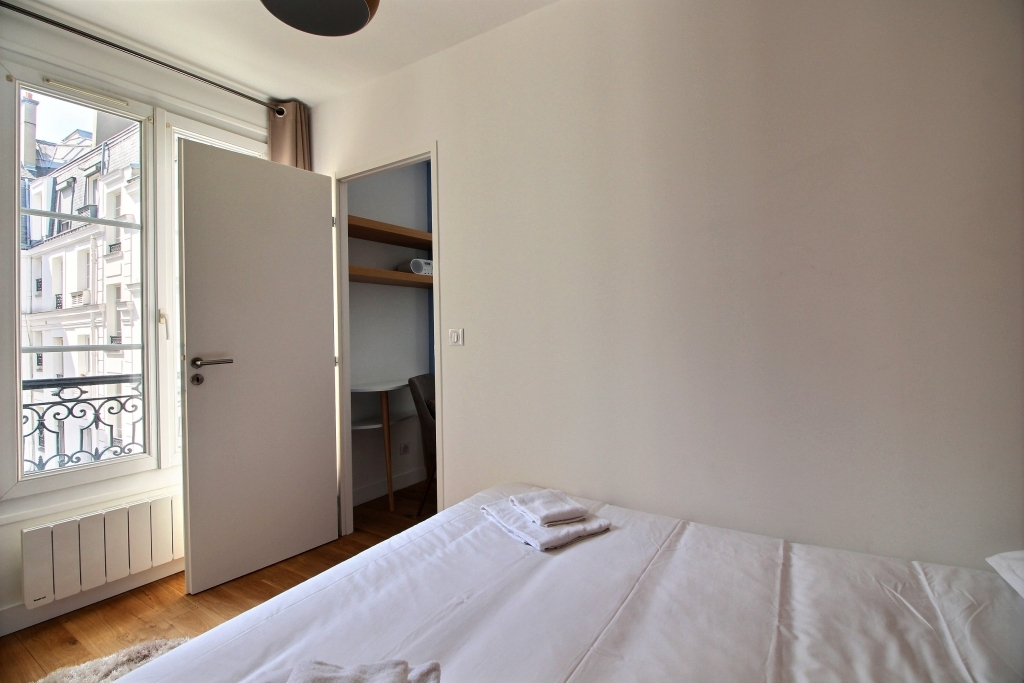 Spacious bedroom at Colisee Apartment