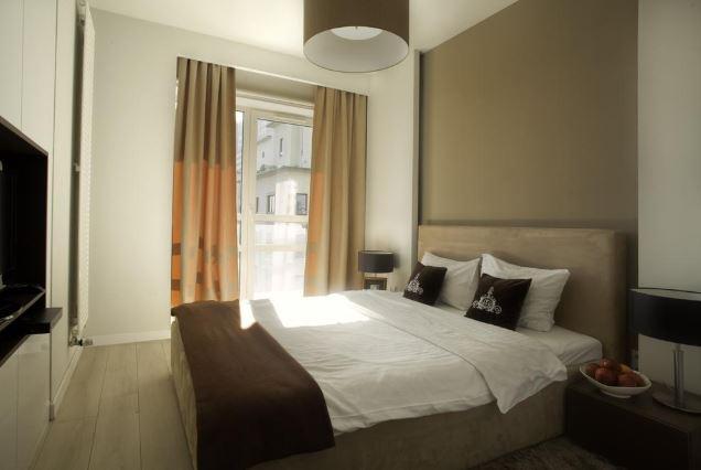 Bright bedroom at Grzybowska Apartments