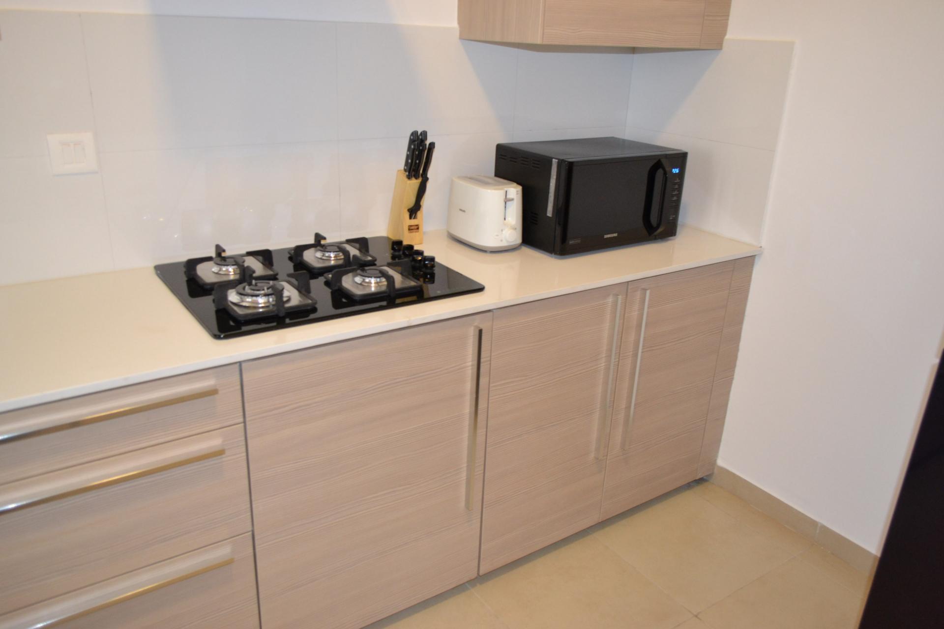 Kitchen at Bhartiya City Apartments